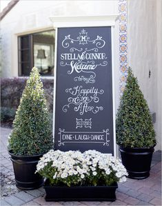 chalkboard wedding signs. Flowers and extra greenery.
