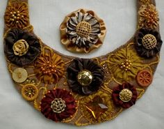 Buttons, beads and embroidery with yo-yo's.
