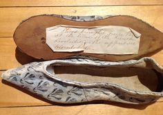 """These unpublished Neoclassical kid slippers are from the Dyer Library/Saco Museum (ME.) Although there is not an established provenance, a handwritten label on the sole of one of them reveals that they were """"brought from Paris at the time of the French Revolution."""" The script looks late 19th-early 20th c. Photographs courtesy Tara Raiselis, Director, Saco Museum. @dyerlibrarysaco"""