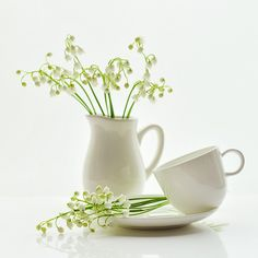 Lily of the valley. This would be lovelier still if the cup position wasn't so awkward. I'd place it either in it right position on the saucer or on the table just on front or behind where it is now.