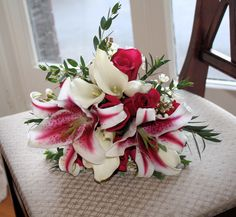 Stargazer liliy, roses and calla lily bridal bouquet by Village Arts & Flowers....