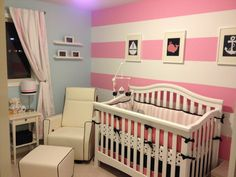Pink and Navy Nautical Nursery - love the striped accent wall! #nautical #nursery #pinkandnavy