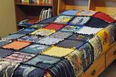 Old T-Shirt Quilt-I saved all of Peter's wrestling shirts over the years and going to make one of these for him!!
