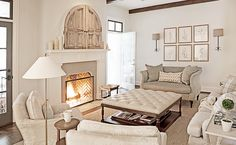 Rachel Halvorson Design - living rooms - living room wood beams, white fireplace mantle, reclaimed wood doors, hidden TV, concealed TV, fire...
