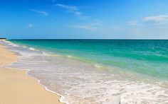 The turquoise waters and sandy beach of Naples, Florida
