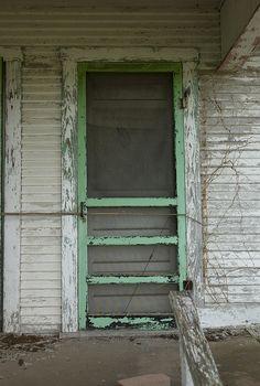 Love this chippy, green door!