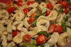 Tortellini Salad with Asparagus and Fresh Basil Vinaigrette - Always a hit at parties and if there are leftovers they are delicious the next day.