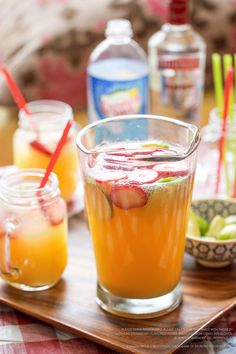 Melt your taste buds with an easy Strawberry Sensation Punch recipe for your July 4th BBQ. Use 15 oz. Smirnoff Strawberry Flavored Vodka, 1.25 cups pineapple juice, 5 oz. orange juice 3.75 cups Canada Dry Club Soda. Shake the first three ingredients in a shaker with ice. Strain into an ice filled Collins glass. Top with club soda and stir. Garnish with a strawberry and a lime peel. 10 servings
