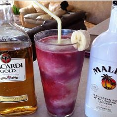 THE LAVA FLOW ~ Red Layer: 2 Cup of Strawberries, 1 1/2 oz. (45ml) Malibu Coconut Rum, 1 1/2 oz. (45ml) Gold Rum Yellow Layer: 1 Banana, 2 oz. (60ml) Pineapple Juice, 2 oz. (60ml) Cream of Coconut | First pour the red layer to fill 1/3 of the glass, then the yellow layer directly down the center