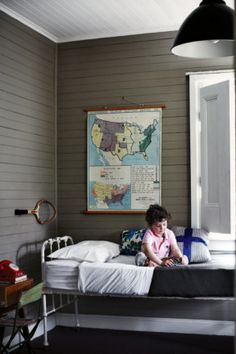 Boys room with vintage maps; my boys would love playing with that phone