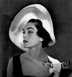 Model in white transparent hat with black velvet base by Madame Paulette, photo by Georges Saad, 1955