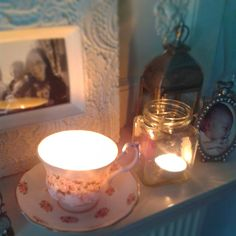 Greatfun4kids: jar lanterns, teacup candle on mantel peice