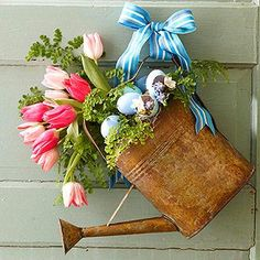 Vintage Watering Can Door Decor ~  Set floral foam in the can to secure the stems. Fill in with spring accents, then wire to door... pretty for Easter