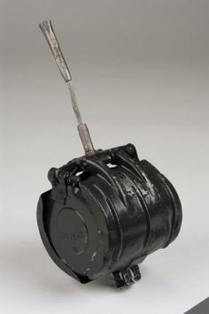 The German SD 2 'Butterfly Bomb' was used on a large scale during the Second World War, and was designed as an anti-personnel/fragmentation weapon. They were delivered by air, being dropped in containers that opened at a predetermined height, thus scattering the bombs. When released, the casing sprang open to form a sort of parachute which also rotated the whole assembly, thus arming the fuze. Several types of fuze could be fitted, ranging from impact to clockwork anti-handling.
