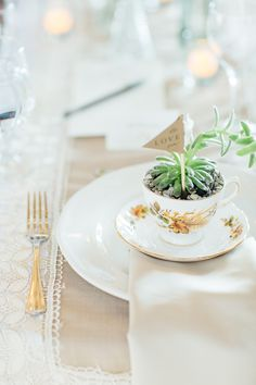Adore these succulent tea cup favors!  #brideside #realwedding #wedding #favor #succulent #teacup #sweet #details   A vintage inspired farmhouse wedding with lace details | Brideside