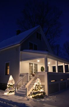 Simple evergreens flank porch stairs
