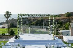 Chuppah covered with greenery for a beach theme wedding by KBY Designs www.themodernjewishwedding.com