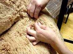 Big Hunka Love Bear getting stitched up!
