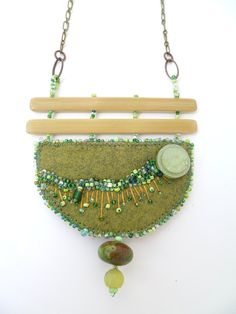 Fragments in green X, mixed media necklace, bead embroidery on felt.