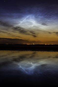 Noctilucent Clouds - Noctilucent clouds (NLCs) form near the top of Earth's polar atmosphere when water vapor from the planet below mixes with meteor debris from space. This photos was taken May 31st 2013 in Scotland, following 15 hours of non-stop geomagnetic storming around earth.