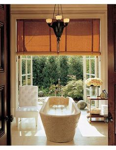 Stephen Sills and James Huniford created a Midwest master bath with floor-to-ceiling French doors that open to the garden. They discovered the antique Italian-marble sarcophagus tub in Belgium, and the circa-1910 chandelier is French.Pin it.