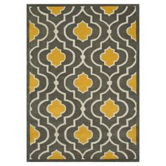 Bring a chic world-traveling spirit to your foyer, living room, or master suite with this lovely wool rug.    Product: Rug...