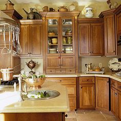 Starring: Limestone   I love the stain on the cabinets!  This is my favorite.