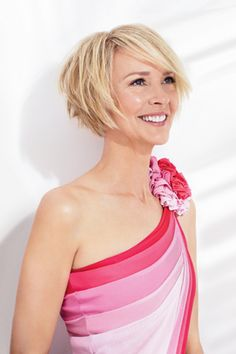 I like this slightly-angled bob but would want slightly shorter sideswept bangs.  Love this top/dress!
