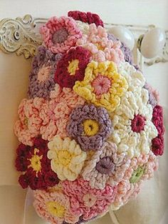 Flower bonnet by Nicki Trench Published in  Cute and Easy Crocheted Baby Clothes