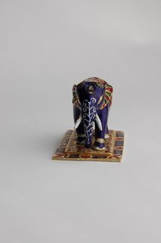 Gold and enamel figurine of an elephant set with diamonds in its back and on its head. Mughal dynasty, 19th-20th century.