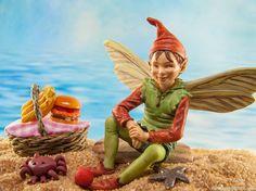 A little fairy enjoys a picnic on the fairy garden beach.