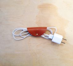 Cord Taco to wrap up that wirey mess. $7.99, via Etsy.