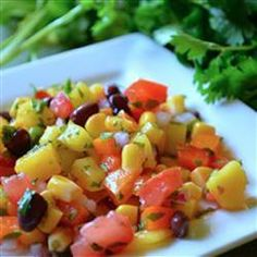 "Black Bean Mango Salsa | ""I love this salsa! It makes for a perfect summer appetizer. I particularly like that it has black beans for extra protein. When served over grilled chicken, it is even better."""