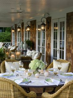 "Reminds me of a  ""Cape Cod"" patio.  Love the shingles, the white french doors and the lighting."