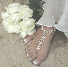 delicate barefoot sandels - ideal footwear for a beach wedding...!