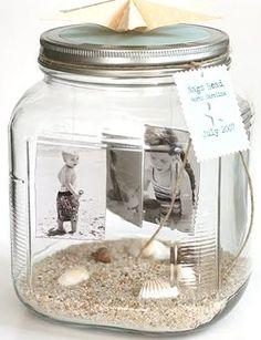 A memory keeping Photo Jar at Fiskars Craft. Photos dangle and a handmade paper starfish is used as a jar topper.