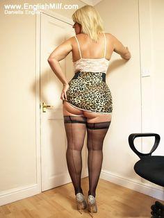 Big arse English milf secretary in ass revealing mini skirt, sexy seamed stockings and heels. Big butt women in nylons British blonde Daniella.