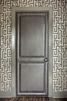 I can soo picture my bathroom doors being enlightened with this!!!    Leather upholstered interior door with nailhead trim (Interesting idea!) wow so cute the possibilities are endless