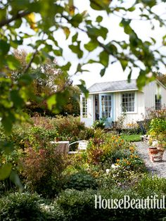 A Charming Guesthouse - add windows and French doors to a potting shed and turn it into a studio and guest room.