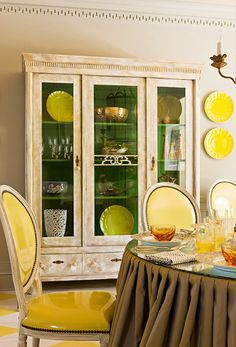 Hmmmmm green interiors, dine room, china cabinets, color, yellow, painted cabinets, chair upholstery, leather chairs, traditional homes