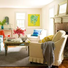 Subtle metallic and mirrored accents, such as the tables and bowl, add shine to complete the airy, family-friendly look: http://www.bhg.com/rooms/living-room/family/real-life-colorful-living-rooms/?socsrc=bhgpin092514whitecanvas&page=10