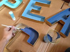 Young House Love - spray painted cardboard letters. Faux vintage look!