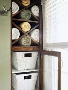 Storage Meets Decor  In the bathroom, storage solutions are often part of the display. Matching woven white baskets hold supplies and coordinate with the bathroom's color palette. X-shape open shelves and glass-front cabinet doors add architectural interest to the vertical storage.