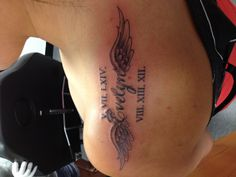 Memorial tattoo - Love the placement, and the name in between the wings, and the halo above the first letter in the name.