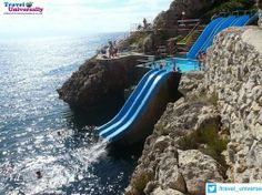 Weekend Fun Gateway : Slide to The Sea 8-) , Sicily , Italy In Sicily, you can slide right into the Mediterranean Sea. Wouldn't you love to be splashing down there right now? :-D For more travel Updates/Offers and Interesting Stuffs be connected to Travel Universally