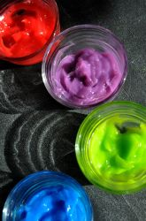 Homemade finger paint with corn stach, salt, sugar, water, and food coloring.