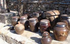 Onggi pots, no doubt packed with kimchi.   Inside a Korean kitchen - Matador Network