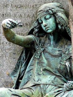 The Flower Seller - Jeune Fille de Bou Saada  (Translation:  Girl of Bou Saada)  ~ Louis–Ernst Barrias 1841-1904  Statue on grave of Artist Gustave Guillaumet in Cemetery of Montmartre in France.