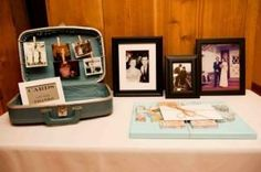 If your loved one liked to travel how about a travel themed memory table? Add lots of photos from their trips, maps and passport. Vintage luggage is a great place to display travel keepsakes. #funeral ideas, #memorial ideas, #funeral memory table, #memory table, #life celebration ideas