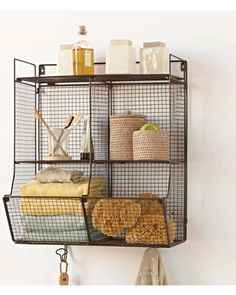 Hang this shelf in your laundry room, bathroom, or entry way! Get it here: http://www.bhg.com/shop/vivaterra-four-bin-wire-hanging-shelf-p5134b307e4b0803cdcf2e952.html?mz=a